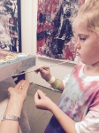 Six Year Old Sydney assist in the finalization process by learning to leaf silver foil reminding us of a bag of chips!